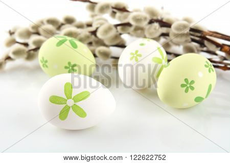 Colourful Easter Eggs With Catkins On White Table