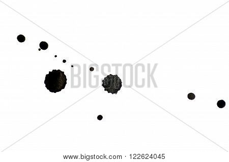 black ink blots on a white background.