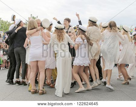 STOCKHOLM, SWEDEN - JUN 10, 2015: Group of happy teenagers dancing at the graduation after finishing high school at the school Globala gymnasiet, June 10, 2015, Stockholm, Sweden