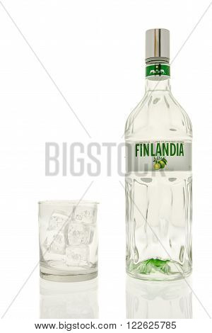 Winneconne WI - 15 March 2016: A bottle of Finlandia lime vodka with a glass of ice