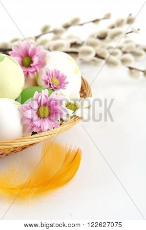 Cropped Shot Easter Eggs In Basket With Flowers And Catkins