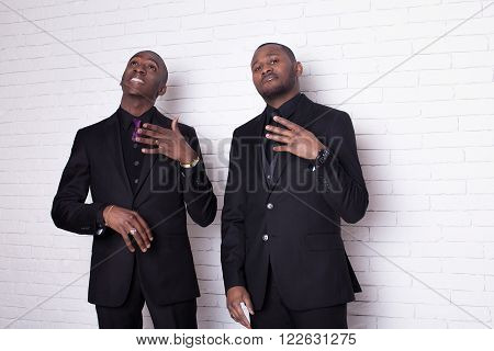two african man businessmen in black suit