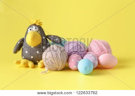 Toy Crow On Yellow Background With Wool Clew
