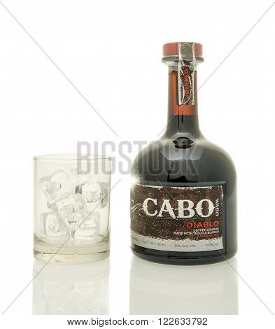 Winneconne WI - 19 March 2016: A bottle of Cabo diablo coffee liqueur with a glass of ice.
