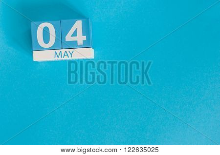 May 4th. Image of may 4 wooden color calendar on blue background.  Spring day, empty space for text.