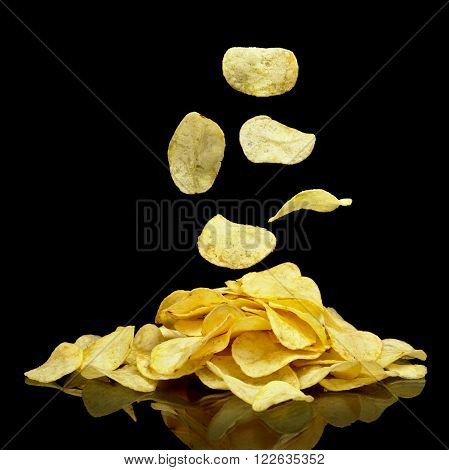 Photo of many potato chips with falling chips
