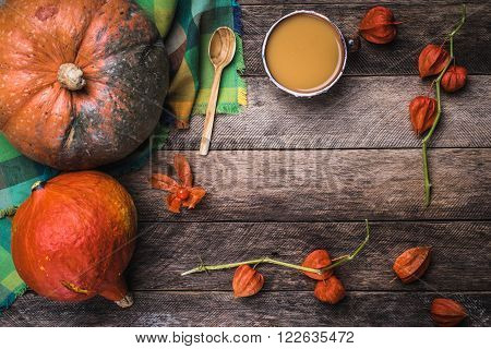 Rustic Style Pumpkins, Soup And Ground Cherry Branches On Wood
