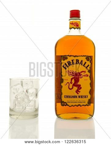 Winneconne WI - 19 March 2016: A bottle of Fireball cinnamon whisky with a glass of ice.