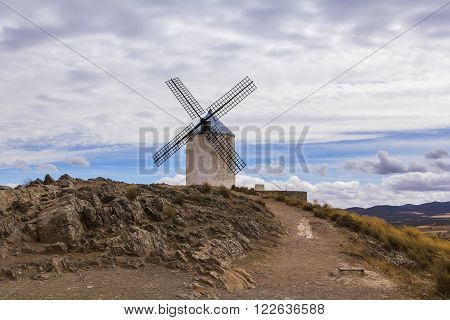 background panoramic view of the windmill Don Quixote and the surrounding hills in Consuegra, Toledo