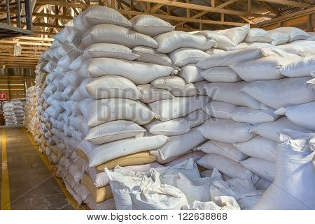 Stack of the white bags at warehouse
