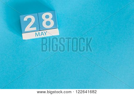 May 28th. Image of may 28 wooden color calendar on blue background.  Spring day, empty space for text.