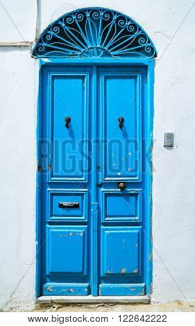 Aged Blue Door In Andalusian Style From Sidi Bou Said