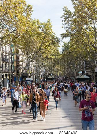 Barcelona - 10 October 2015: Many people and tourists stroll on the main tourist street of Barcelona - Rambla October 10 2015 Barcelona Spain