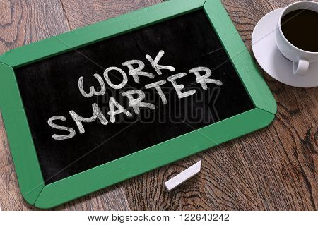 Hand Drawn Work Smarter Concept  on Small Green Chalkboard. Business Background. Top View. 3D Render.