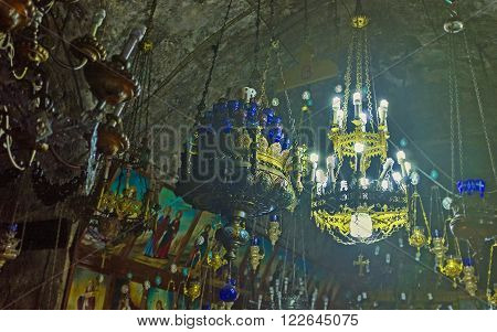 JERUSALEM ISRAEL - FEBRUARY 16 2016: The old chandeliers and oil lamps hang from the ceiling of Church of the Assumption (Mary's Tomb) on February 16 in Jerusalem