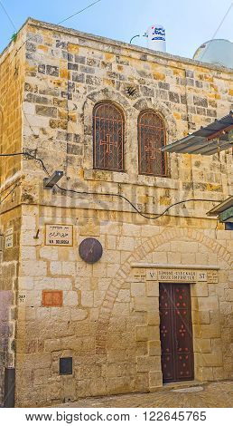 JERUSALEM, ISRAEL - FEBRUARY 16, 2016: The Franciscan Church of Simon the Cyrenian is the fifth station on Via Dolorosa street, the way of Jesus and pilgrims' route, on February 16 in Jerusalem.