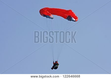 Paraglider using big ears for rapid descent