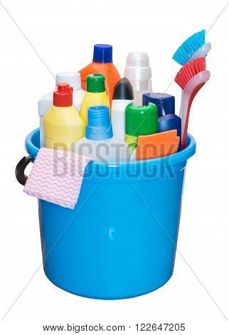 Detergents in color bottles brush and napkins in a bucket isolated on a white background.