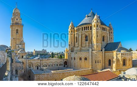 The house roofs are the best viewpoint overlooking the huge building of the Dormition Abbey with its clock tower and tiny belfries Jerusalem Israel.