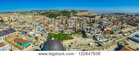 The panoramic view on the old city with the Dome of the Rock and the Mount of Olives on the background, Jerusalem, Israel.