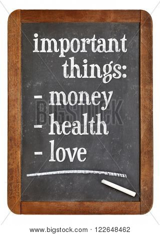 Money, health and love - list of important things on a vintage slate blackboard