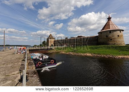 ORESHEK FORTRESS, SHLISSELBURG, RUSSIA - AUGUST 9, 2015: Tourists in the trip boat at the fortress Oreshek. The fortress founded in 1323 is included in the UNESCO World Heritage List