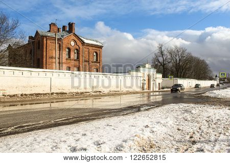 Staraya Ladoga, Russia - 23 February 2016, Cars passing along the walls of the monastery, 23 February 2016. Tourist places in the great ancient route from the Vikings to the Greeks.Staroladozhsky Holy Assumption nunnery. Gold ring of Russia.