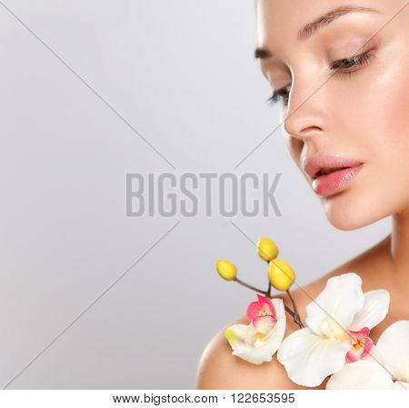 Woman in towel with orchid flowers