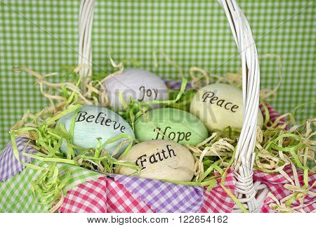 inspirational message on Easter eggs in wicker basket