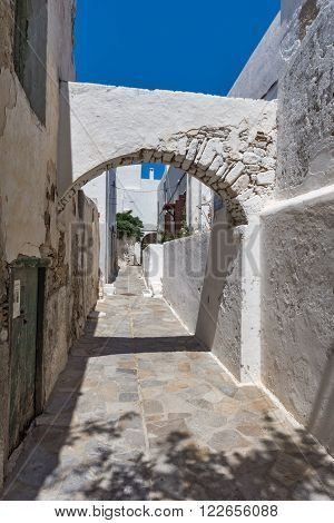 Street with White houses in the fortress in Chora town, Naxos Island, Cyclades, Greece
