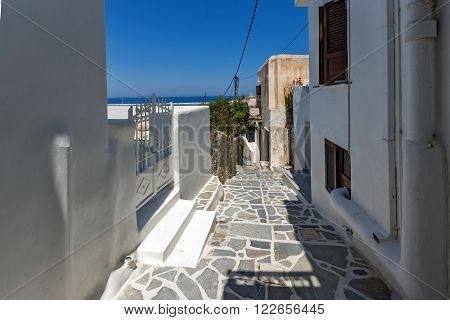 Street and white houses in Chora town, Naxos Island, Cyclades, Greece