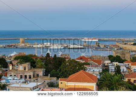 Greece, Rhodes - July 12 Panorama of the port and the old town in the evening on July 12, 2014 in Rhodes, Greece