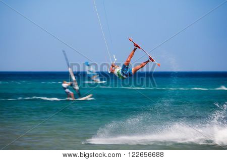 Greece, Rhodes - July 16 Kitesurfer jumping on Prasonisi on July 16, 2014 in Rhodes, Greece