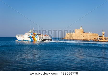 Greece, Rhodes - July 19 The ship on a background of the fortress of St. Nicholas on July 19, 2014 in Rhodes, Greece