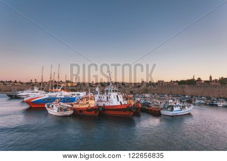 Greece, Rhodes - July 13 Port city and fortress walls on July 13, 2014 in Rhodes, Greece