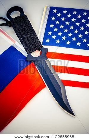 United States of America and Russia flags with knife - cold war conflict