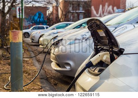 Montreal, CA - March 21th 2016. Electric cars charging at recharging station.
