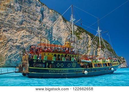 ZANTE ISLAND, GREECE - CIRCA JUNE 2015: Tourist Cruise Boat in Navagio Bay