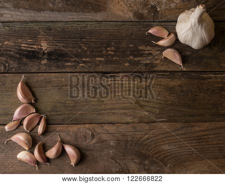garlic on wooden background frame for text