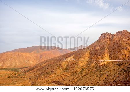 Mountain landscape at the central part of Fuerteventura island on the cloudy and foggy weather in Spain