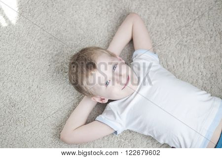 Little Kid At Home On A Carpet