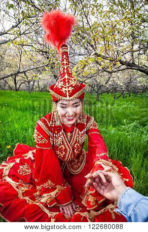 Woman In Kazakh Costume With Wedding Ring
