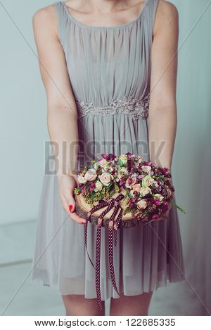 Close up image of bridesmaid holding a wedding decoration