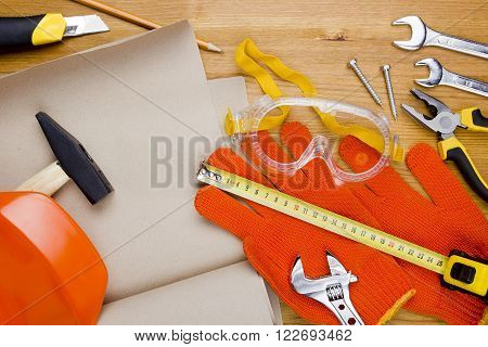 Safety equipment for construction industry on a wooden background