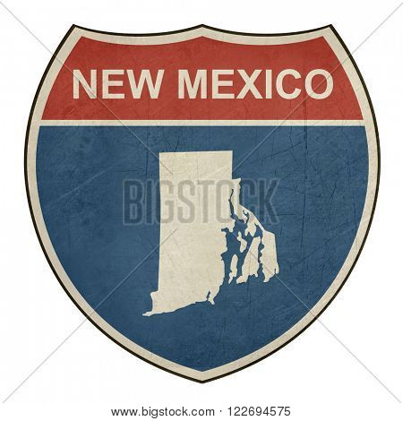 Grunge New Mexico American interstate highway road shield isolated on a white background.