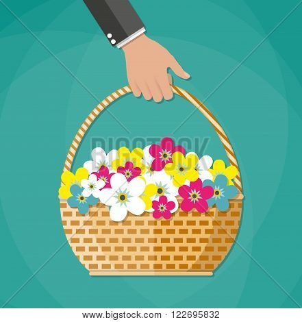 Hand Carrying Brown woven wicker basket with color flowers. vector illustration in flat design on green background