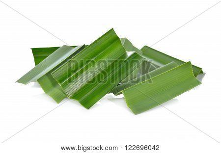 portion cut fresh pandan leaves on white background