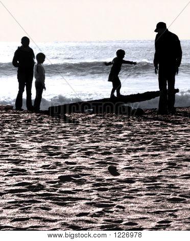 Beach Family At Sunset