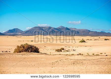 Mountain range on Corralejo dunes on Fuerteventura island in Spain