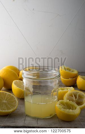 A Glass Of Lemon Juice Alongside Fresh Lemons